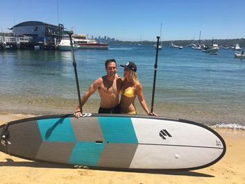 couple stand up paddle